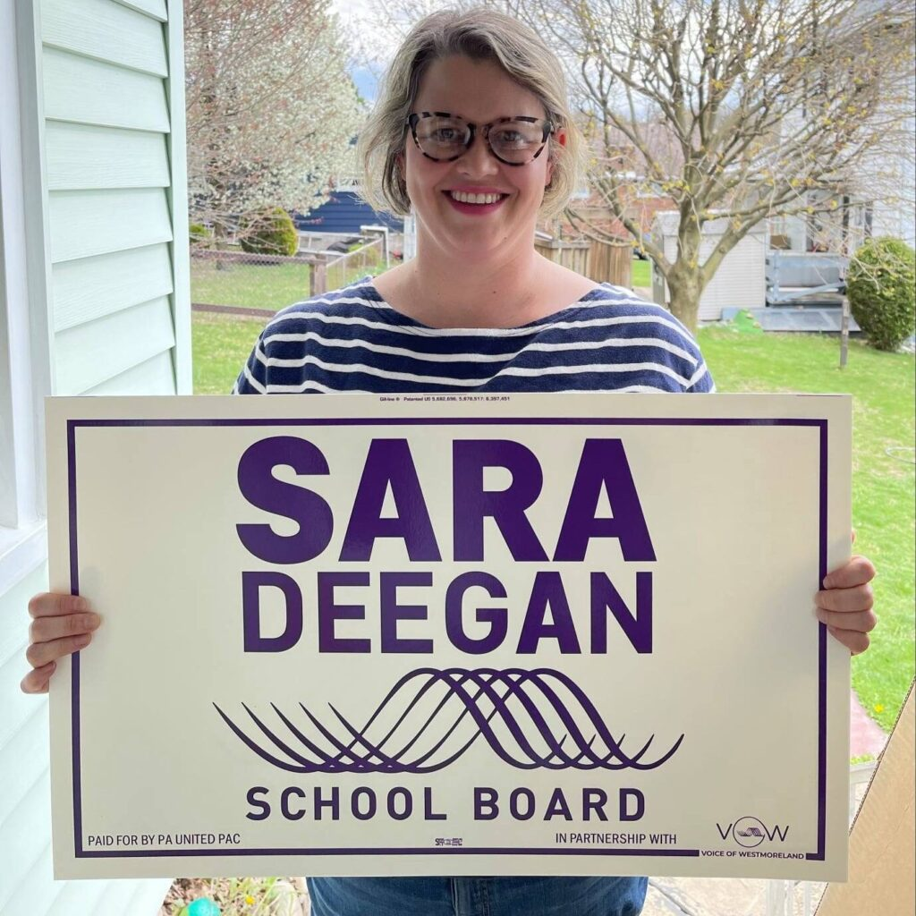 Sara Deegan holding one of her campaign signs